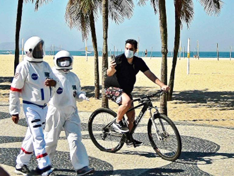Couple from Brazil dons astronaut suits to fight the coronavirus in style